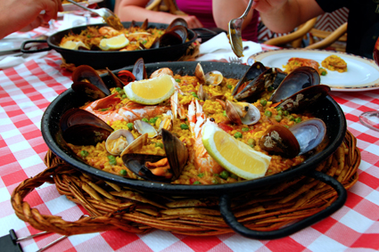 Soak up the flavors of Paella: saffron, rosemary, olive oil, and seafood